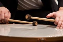 Hands musician playing timpani closeup Stock Images
