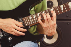 Hands of musician put guitar chords close up Royalty Free Stock Photos