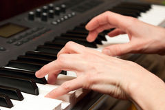 Hands of the musician on a synthesizer Royalty Free Stock Image