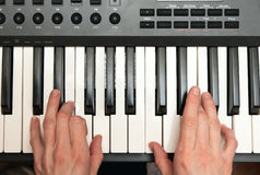 Hands of the musician on a synthesizer Stock Photography
