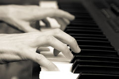 Hands of the musician on a synthesizer Stock Images