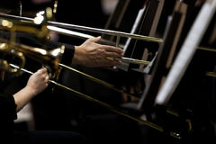 Hands of musicians played the trombone in the orchestra Royalty Free Stock Photos