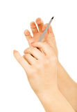 Hands with nail file Royalty Free Stock Photography