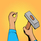 Hands with nail and hammer pop art vector Stock Images