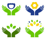 Hands with nature symbols. Hands holding flowers and leaves objects. Vector Stock Image