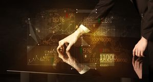 Hands navigate on high tech smart table with business icons stock photography