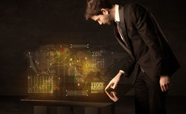 Hands navigate on high tech smart table with business icons Stock Images