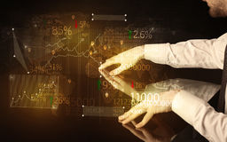 Hands navigate on high tech smart table with business icons Stock Image