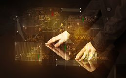Hands navigate on high tech smart table with business icons Royalty Free Stock Photos