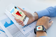 Hands with navigator map on smart phone and watch. Business, technology and people concept - close up of woman hand holding transparent smartphone and smart royalty free stock photos