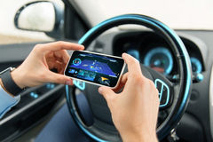Hands with navigator on smartphone in car Royalty Free Stock Image
