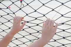 Hands with net, Hands with rope mesh fence Stock Photography