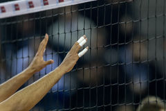 Hands on net during the Hellenic Volleyball League game. Thessaloniki, Greece - February 6, 2017: Hands on net during the Hellenic Volleyball League game Paok vs royalty free stock photo