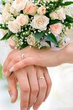 Hands of new married Stock Images