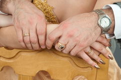 Hands of a newly-married couple. Royalty Free Stock Photography