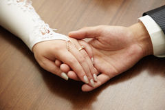Hands of newly-married couple Royalty Free Stock Photos