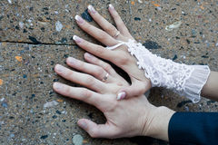 Hands of the newly-married couple Royalty Free Stock Images