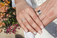 Hands of newly married couple with rings Stock Photo