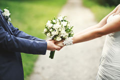 Hands of a newly wed couple together. Road of love and happiness, hands of a newly wed couple together Royalty Free Stock Image