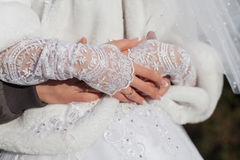 Hands of newly wedded in sunny day on open air Royalty Free Stock Images