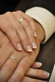 Hands of newlywed couple Stock Images