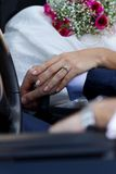 Hands of newlyweds in cabrio Stock Photography