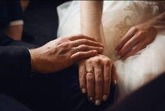 Hands newlyweds with rings royalty free stock photo