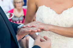 Hands of the newlyweds with rings at the wedding ceremony Stock Photos