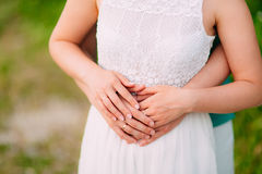 The hands of the newlyweds with rings Stock Photography