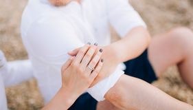 The hands of the newlyweds with rings Stock Photos