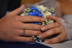 Wedding background, newlyweds hands with rings. Wedding hands of the newlyweds with wedding rings Royalty Free Stock Images