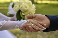 Hands of the newlyweds with rings. Wedding hands of the newlyweds with wedding rings Royalty Free Stock Images