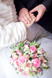 Hands on the wedding bouquet Stock Photos