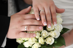 Hands of the newlyweds with wedding rings Royalty Free Stock Photography