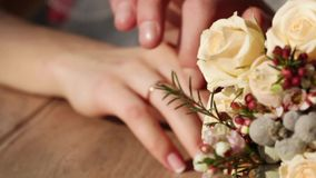 Hands next to wedding bouquet Stock Photography