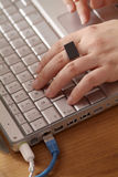 Hands on notebook Stock Image