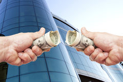 Hands with notes of dollars against office building Royalty Free Stock Photography