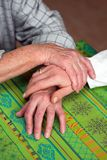 Hands of a nurse and a former senior Stock Photo