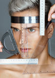 Hands nurse make measurements on the patient's head before cosmetic surgery. Stock Images