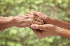 Hands Of An Elderly Senior Holding The Hand Of A Woman Royalty Free Stock Image
