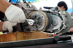 Hands Of Disassembly Kit Motorcycle In Repair Service. Stock Photography