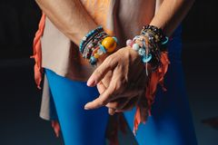 Free Hands Of Mature Woman In Colorful Accessories On Wrists And Colo Stock Photo - 129195080