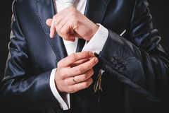 Free Hands Of Wedding Groom Getting Ready In Suit Royalty Free Stock Image - 53774176