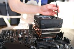 Free Hands Of Young Male Master Install Cooler With Copper Heat Pipes For The Processor, Other Parts Of Pc Into Case, The Concept Of Stock Image - 216627401