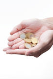 Hands offering a bunch of euro coins isolated Royalty Free Stock Photo