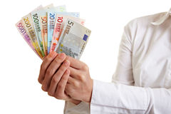 Hands offering fan of Euro money Royalty Free Stock Photography