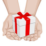Hands offering a gift Royalty Free Stock Image