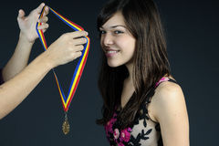 Hands offering golden medal royalty free stock photo