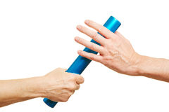 Hands offering relay baton during race Royalty Free Stock Photo