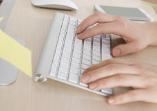 Hands of an office business woman typing on the keyboard Stock Photo